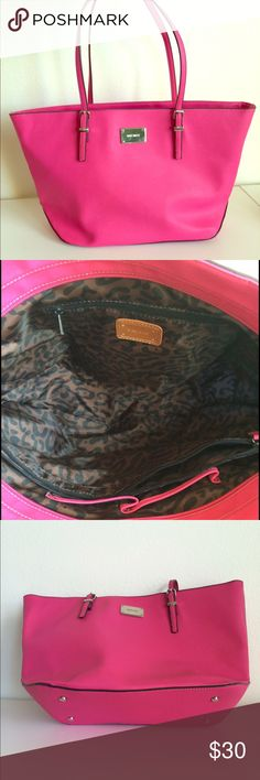 Bright pink Nine West purse Fabulous bright pink Nine West purse in excellent condition. Leopard interior. About 19/20in from one end to another Nine West Bags Shoulder Bags