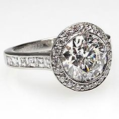 This magnificent Tiffany & Co diamond engagement ring features a very desirable halo style mounting and is previously owned and in very good condition.