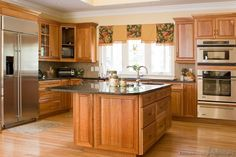 I like this combo medium golden cabinets with lighter wood floor.  Feels rich.  Traditional Medium Wood-Golden Kitchen Cabinets #10 (Kitchen-Design-Ideas.org)