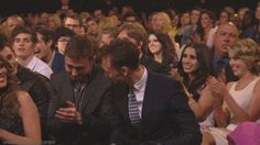 Tom wants a hug NOT a handshake!!! (Evans and Hiddleston winning award at MTV Movie Awards 2013)