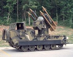 MIM-72 Chaparral. This self propelled AA vehicle is based on the versatile M113 APC chassis and uses the M-10 sidewinder missile stystem. Designed for long range AA, it was paired with the M163 Vulcan air defense system, also mounted on an M113 chassis, which would engage aircraft closer in. Both have now been replaced in US service by the Avenger air defense system, mounted on a modified Humvee. The Chaparral is still in use with several nations.
