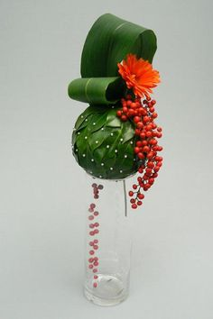 """Dripping Jaffas"" - Camellia leaf sphere with Aspidistra, Gerbera & Idesia berries ~ Anne Bell"