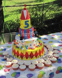 cute but change colors to brighter with bright green blues...Carnival birthday cake provided by Mon Petite Cake Shop Garland 75043
