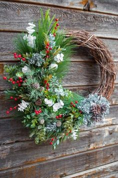 Learn how to make a DIY winter grapevine wreath for your seasonal home decor. This winter wreath idea is perfect for your front door and features traditional, winter elements including pinecones, pine needles, eucalyptus, winter berries and faux spray snow. Handcrafted using faux floral supplies from the craft store, this DIY winter wreath is perfect as a winter decoration for your front door throughout the season. Diy Wreath, Grapevine Wreath, Wreath Ideas, Door Wreaths, Poinsettia Plant, Candy Cane Ornament, Christmas Room, Christmas Projects, Winter Home Decor