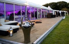 Wedding furniture hire - marquee with sofas on decking LUSH!!! ....Exactly what we think of in Sheffield.... this looks amazing and whoever came up with the design and theme deserves a big credit....well done!