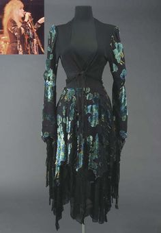 "A black crepe shawl and scarf with green and blue flowered velvet brocade worn by Stevie Nicks in a video for the Fleetwood Mac song ""Rhiannon."""