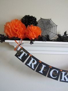 Halloween Tissue Paper Pom Poms by ThePomPomShop