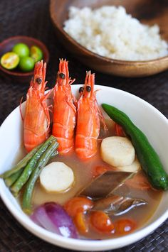 Filipino Shrimp Sinigang (Sinigang na Hipon) recipe - Sour, salty, with a hint of sweet and bitter, Sinigang is one of the Philippine's most loved dishes. The dish is easily adaptable depending on what protein is on hand, but most frequently made with pork, beef, or prawns. #filipino #soup #seafood