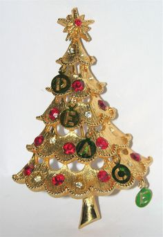 "Just like Joan's Christmas tree pin.except mine has the ""PEACE: letter tag charms, too! Jewelry Christmas Tree, Jewelry Tree, Christmas Signs, Christmas Tree Ornaments, Vintage Christmas, Christmas Holidays, Holiday Jewelry, Vintage Brooches, Vintage Jewelry"