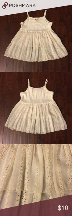 """Ivory Embroidered Swing Little Girl Top Ivory Embroidered Detail Swing Little Girl Dress  ☀️Self: 100%Polyester  ☀️Lining: 95%Rayon 5%Spandex ☀️Made in USA  🕊I accept reasonable offers!! I truly do! With  the exception of items labeled """"Price Firm""""  🕊Serious buyers please & No Low ballers! Asking for half or more off an item is Low Balling.   🕊Please understand the sizes listed on the size chart are different between manufacturers & suppliers & this chart should only be used as an…"""