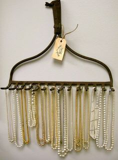 Old rake re-purposed as a necklace holder—so shabby chic!