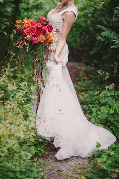 Cascading orange, red, and green bridal bouquet in a Midsummer Night's Dream wedding inspiration shoot from Sweet Root Village. Summer Wedding Bouquets, Fall Wedding Bouquets, Bride Bouquets, Flower Bouquet Wedding, Autumn Wedding, Floral Wedding, Wedding Colors, Fall Bouquets, Flower Bouquets