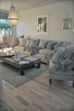 Beautiful cosy lounge. White, grey, wood, candles.