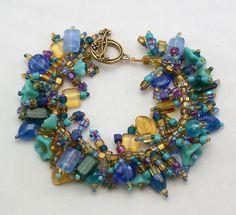 "Bracelet: ""Peacock"" Glass beads in rich colors! Fringe Magic #FringeMagic #Fringe"