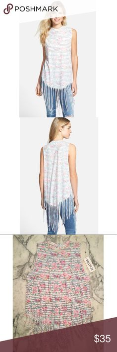 """Wildfox Striped Floral Gypsy Fringe Tank (S) Wildfox Couture So 90's Gypsy Fringe Tank. Lightweight tissue jersey with long, loose body, scooped crewneck, open armholes and flowing fringe trim. The 'So 90's' print is one of their best...combo of soft nautical stripes and colorful flowers. This top has been modified...the super long graduated fringe was trimmed, about 6"""" cut off. You can see by photos, it is much more wearable for everyday. 50% Cotton, 50% Polyester. Unworn condition…"""