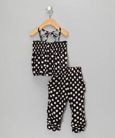 Take a look at this Navy Polka Dot Smocked Halter Top & Capri Pants - Toddler & Girls on zulily today!