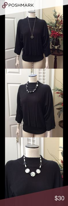 Black mock turtleneck sweater Solid rich black mock turtleneck. Can dress it up or down with all kinds of jewelry. Jeans or dress pants. Maybe a skirt.  72% rayon 28% nylon. Sleeves are wide full sleeves.  From under the armpit they measure 13 inches.  Armpit to armpit is 20 inches.  Top to bottom 25 inches. investments Sweaters Cowl & Turtlenecks