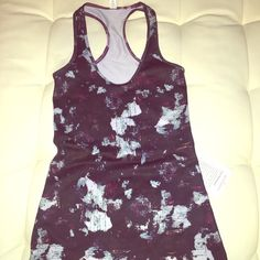 New Lululemon tank top racerback Brand new with tag, made of luon. Super cute and coumfy a size too small for me. Beautiful contrast with their Bordeaux or maroon color lululemon athletica Tops Tank Tops