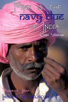 Pink is the navy blue of India.  Pink turban at Pushkar Camel Fair, Rajasthan, India. InsightTravels.com