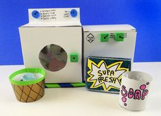 Take a suds and spin in our optimistic washer and dryer! Book Projects, Projects For Kids, White Poster Board, Brass Fasteners, Fabric Softener Sheets, Box With Lid, Clothes Line, Masking Tape, Washer And Dryer