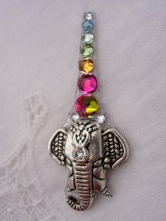 colorful elephant bindi - symbolizes Lord Ganesha and the seven chakra colours Indian Jewelry, Boho Jewelry, Jewelery, Jewelry Accessories, Colorful Elephant, Face Jewels, Festival Fashion, Festival Style, Tribal Dance