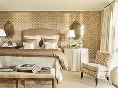 There's nothing boring about this room with pattern on walls & chair, variety of  textures & natural colors.
