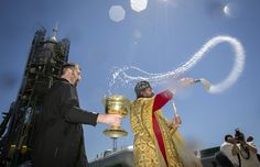 An Orthodox priest (C) conducts a blessing service in front of the Soyuz TMA-09M spacecraft on the launch pad at Baikonur cosmodrome May 27, 2013. Soyuz with U.S. astronaut Karen Nyber, Italian astronaut Luca Parmitano and Russian cosmonaut Fyodor Yurchikhin is due to travel to the International Space Station on May 29. (Photo by Shamil Zhumatov/Reuters) http://avaxnews.net/fact/The_Week_in_Pictures_May_26-May_31_2013.html