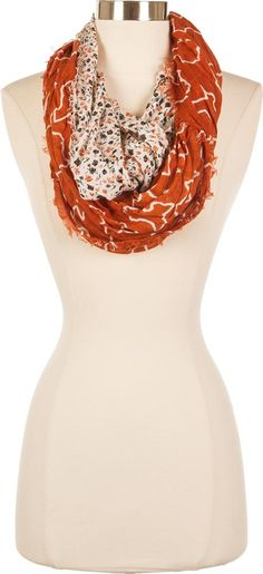 Display Longhorn spirit during this winter with a Texas infinity scarf! Half Texas themed, half floral, this split scarf will keep you warm! Get yours now!