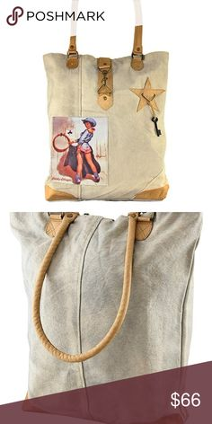 Vintage Addiction Tan Pin Up Cowgirl Canvas Tote PRODUCT DESCRIPTION: Leather and metal accents lend a chic touch to this trend-right tote. Its roomy interior keeps cash, cards and other must-haves close at hand.  Note: Due to the manufacturing process, actual colors may be different than shown.  17'' W x 16'' H x 4'' D 11.5'' handle drop Cotton / leather / metal Clasp closure Interior: one interior pocket Imported Vintage Addiction Bags Totes