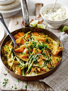 Squash and bean curry recipe from Madeleine Shaw. This hearty, warming dish is a great weekday dinner for cold autumn nights.