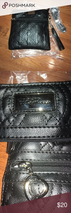 "Bella Russo crossbody purse black NWOT Crossbody strap 24"". Black with outside zipper pocket and heart pull. Inside zipper pocket and two clear interior pouch pockets. Removable decorative tassel. Paisley print inside. Approx 10 ""x 10"" quilted design on purse. Brand new never used. Bella Russo Bags Crossbody Bags"