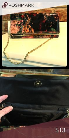 New Super Cute clutch with gold chain strap. Perfect for a little Pop with your casual or evening outfit. Black with gold detailing and flower design clutch with a thin gold chain for a strap (it can be tucked inside the purse if you don't want to use it). This item is new from Jessica McClintock. Jessica McClintock Bags Clutches & Wristlets