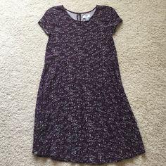 Purple Flowy baby doll dress Super cute floral dress! Very comfy but still stylish! It's a kids XL but it fits a woman's small! Dresses