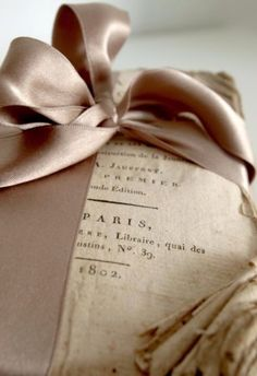 Book no cover  wrapped with Tan Ribbon