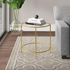 Ebern Designs Deford End Table Colour: Gold Glass Top End Tables, Metal End Tables, End Tables With Storage, Coffee Table With Storage, Velvet Wingback Chair, Small Accent Tables, Etagere Bookcase, Gold Table, Barrel Chair