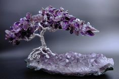 I had planned to have one tree at either end of this amethyst cluster, but as soon as this tree was on it, I knew it was done. Made with amethyst chips . Safe Haven Handmade Wire Jewelry, Handmade Beads, Wire Tree Sculpture, Sculptures, Crystal Tree, Amethyst Geode, Amethyst Cluster, Crystal Cluster, Purple Trees