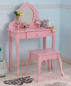 Little ones love primping and prepping for the day with this vibrant vanity set. Featuring sturdy construction and sensational style, it's sure to make them feel special. The unbreakable plexiglass mirror ensures that this will be a beloved hand-me-down, and the large drawer and two shelves are perfect for holding trinkets and treasures.