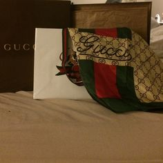 Gucci scarf in silk Gucci silk scarf with original designer monogram and authentic green and red stripe. 100% silk twill Accessories Scarves & Wraps