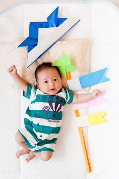 May 5th is the Boy's festival.I took a baby with a carp streamer and a samurai warrior helmet.Those were made with origami.