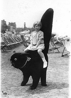 Two children pose with a giant cat on the beach in Margate. 1920s.   [photographer unknown]