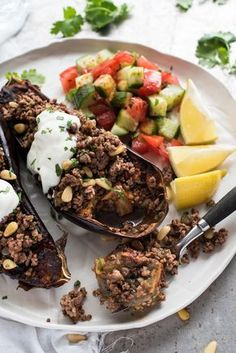 Eggplant smeared with Chermoula, a simple Middle Eastern Moroccan spice paste made with everyday spices, baked until crispy on the surface and molten inside, then topped with a delicious spiced minced / ground beef.