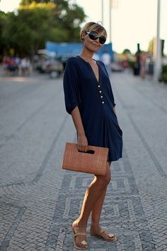 Navy romper, tan clutch, gold sandals, and oversized sunglasses. Love this!! So me
