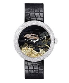 The Chanel Mademoiselle Privé Coromandel dial watches are made using the  'grand feu' enamel painting technique and inlaid with gold. All three of this models have white gold cases decorated with over 600 diamonds set in a random 'snow-setting' pattern.