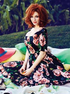 Christina Hendricks. I wish upon wish I could pull off the hot, pin up redhead. Instead, I'm just the klutzy friend.