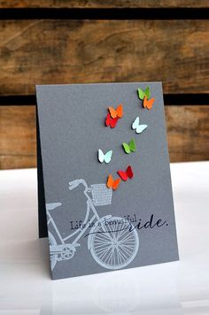 witticisms: Pedal Pusher. Love the simplicity of the white rubber stamped bike on a black background. The butterflies finish it perfectly.