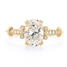 Remarkably sparkling, this handcrafted yellow gold engagement ring features an oval-shaped vintage diamond, surrounded by luxurious details for a truly glamorous look.  at Greenwich Jewelers