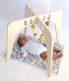 Coolest baby gifts of the year: Wooden baby play gym from Nin and June | Cool Mom Picks Editors' Best