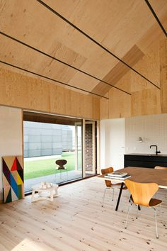 Copenhagen office Leth & Gori used exposed clay blocks and raw plywood to create a maintenance-free interior for this house in Nyborg, Denmark