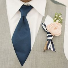This flower is felted but love the blue/white ribbon tie and use real flowers
