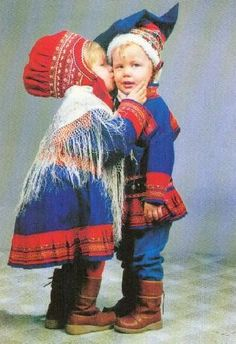 Cute pair of Finnish Sami children in traditional costumes of Lapland